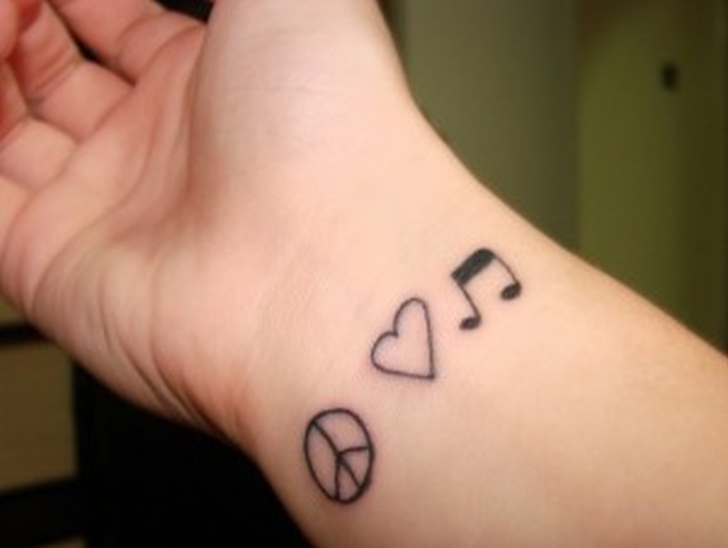 Peace heart music tattoo on wrist
