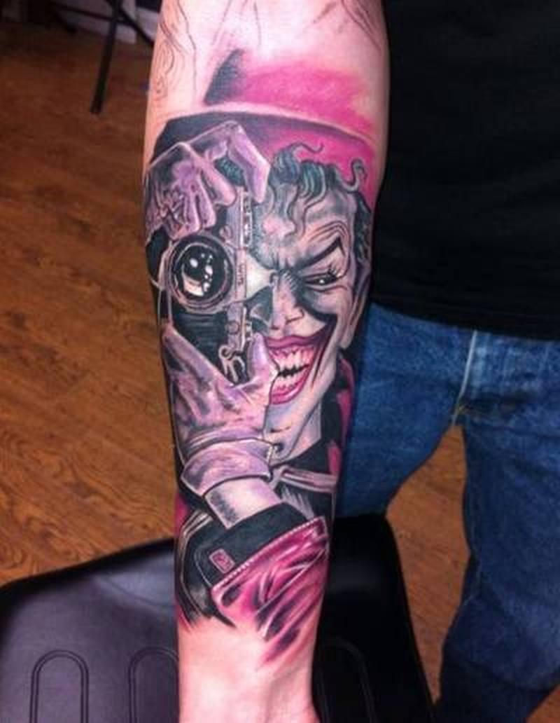 Photographer joker tattoo on arm