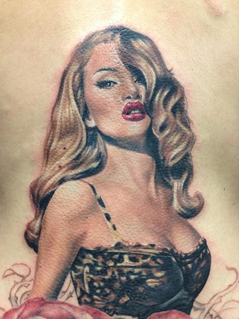 Pin up girl in leopard print bikini tattoo by Randy Engelhard