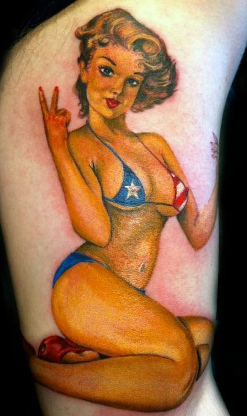 Pinup girl in bikini colors of american flag tattoo