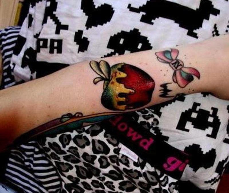 Poison red apple with bow design tattoo