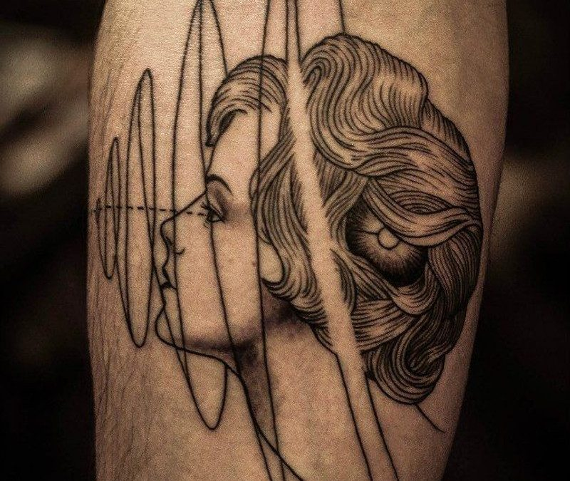 Portrait of a girl and geometric symbols forearm tattoo
