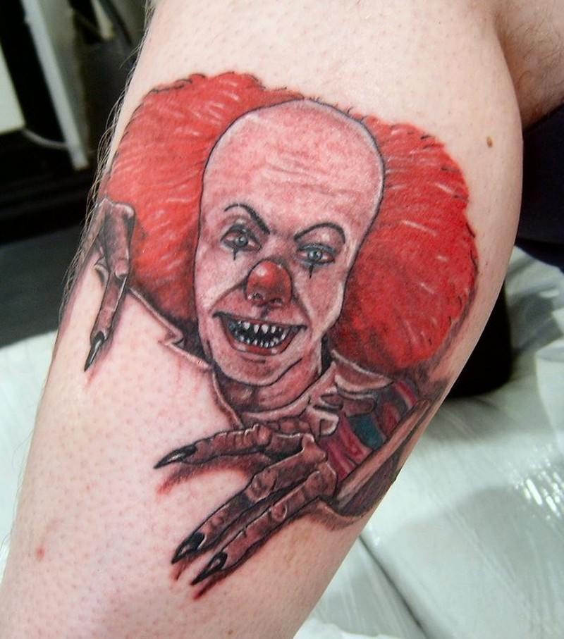 Portrait of a terrible red haired clown skin rip tattoo