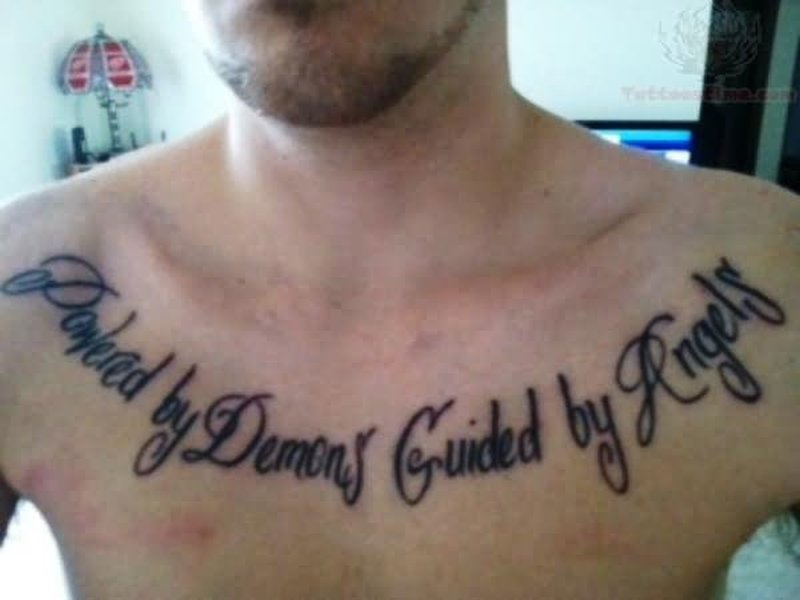 Powered by demons guided by angels tattoo on collarbone