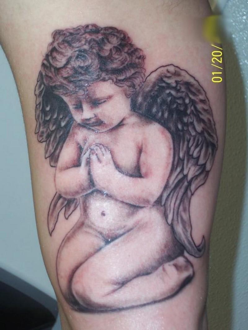 Praying baby cherub tattoo