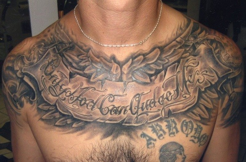 Quote and patterns tattoo on chest for men