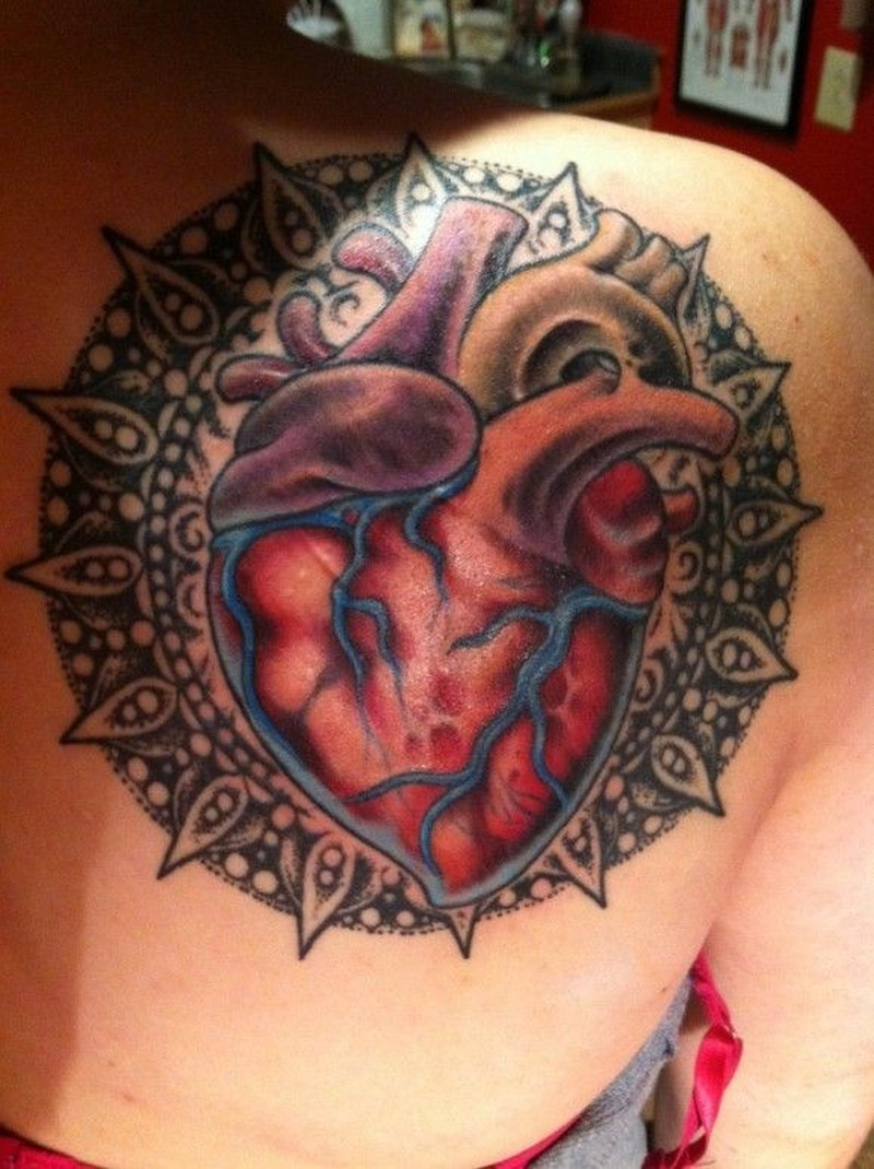 Realistic heart with mandala tattoo by Rob Hunt