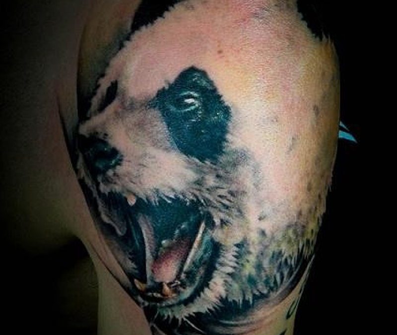 Realistic panda head tattoo