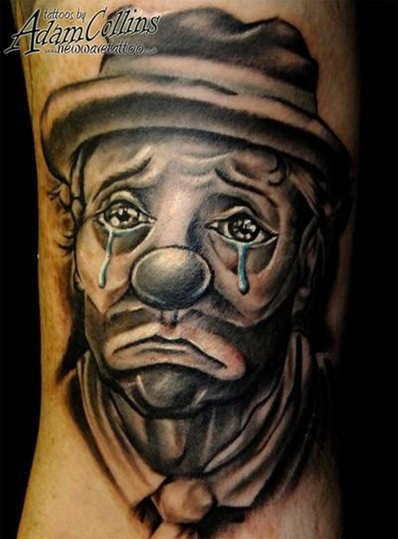 Realistic tearful clown tattoo