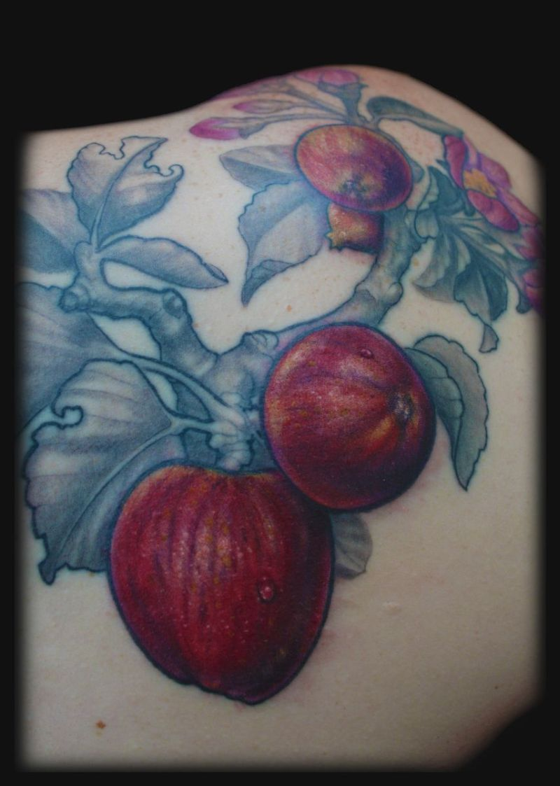 Red apple blossom design tattoo