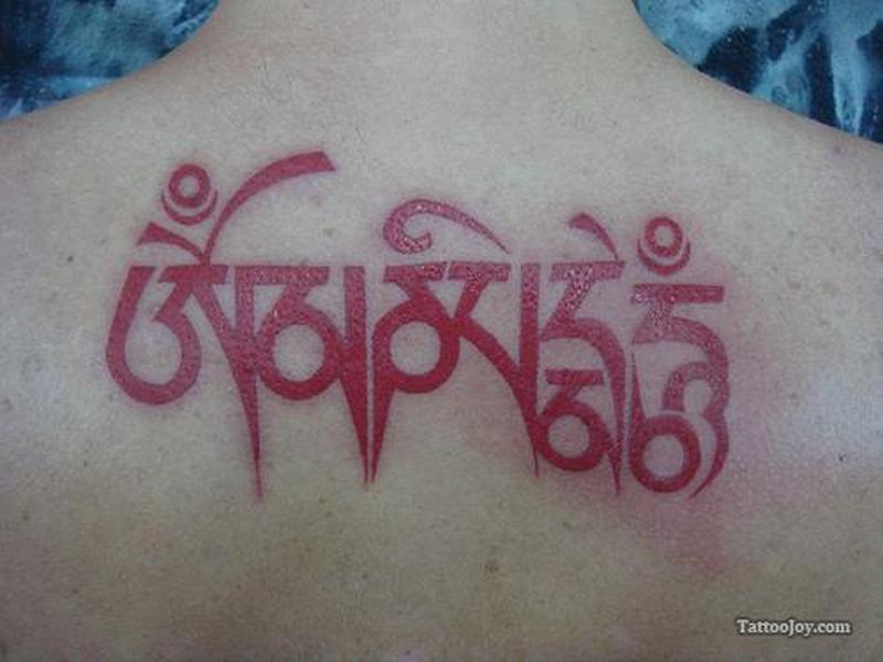 Red ink buddhist mantra tattoo