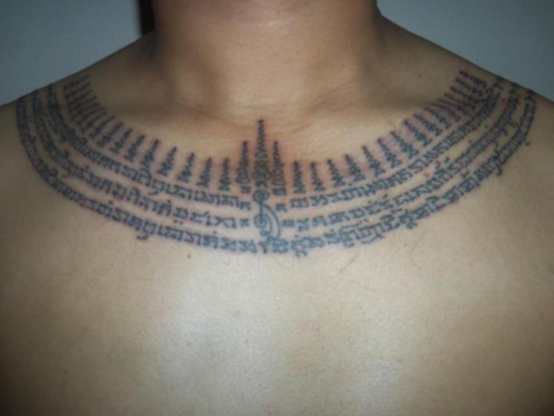 Religious buddhist tattoo design on chest