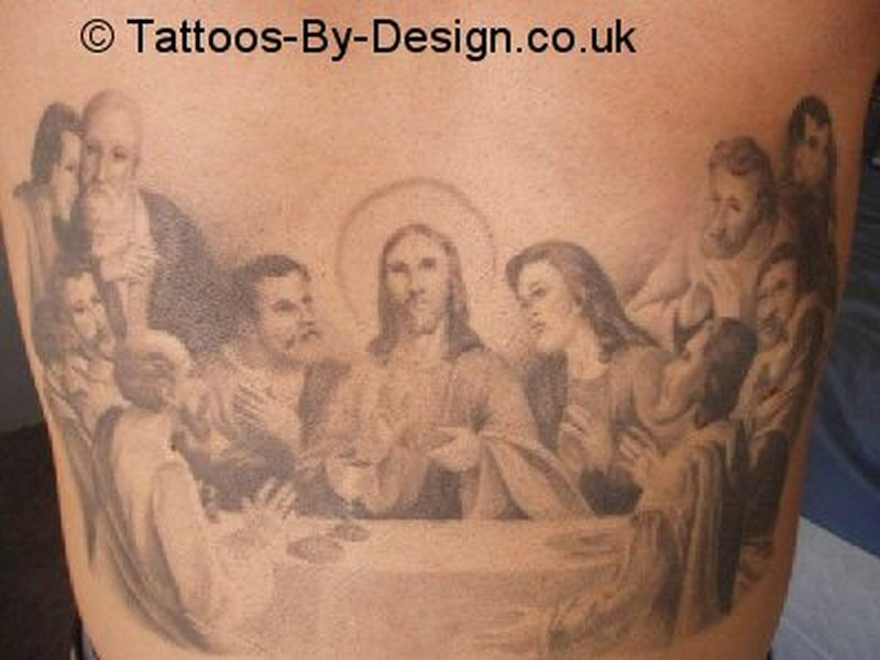 Religious jesus tattoo on back body
