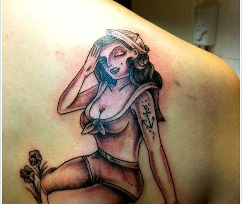 Sailor pin up girl tattoo on shoukder blade
