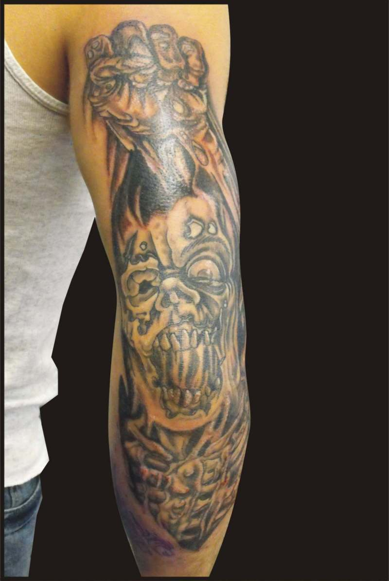 Scary elbow tattoo