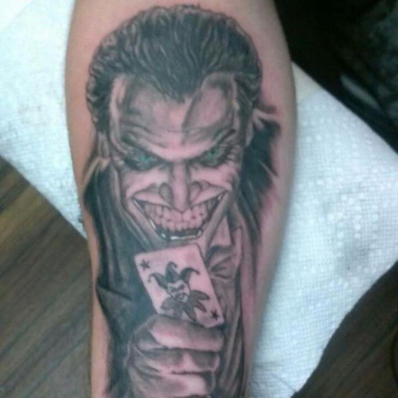 Scary joker tattoo image