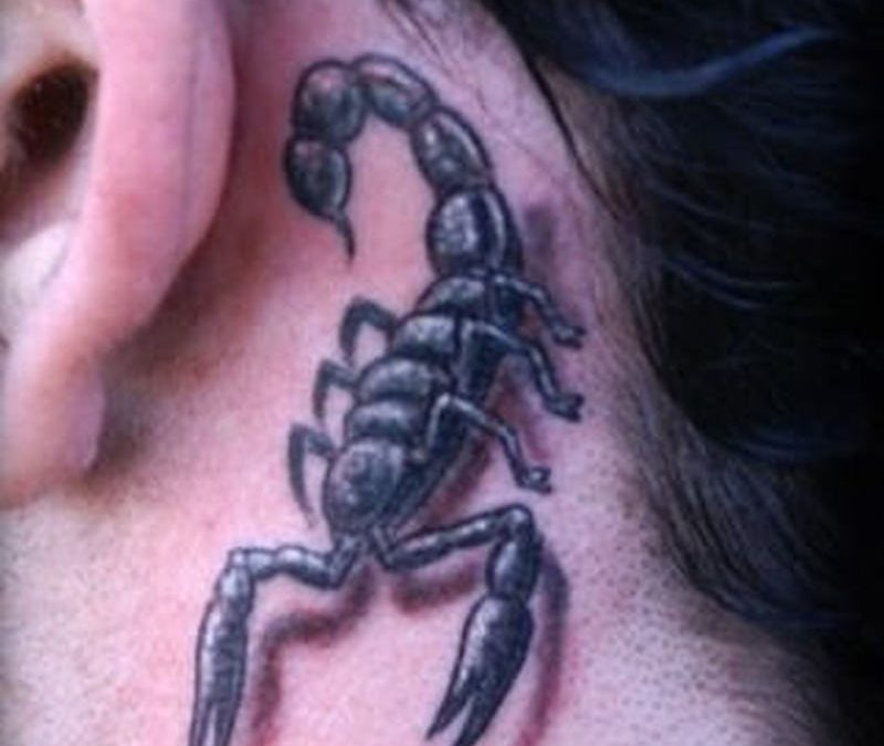Scorpion behind ear tattoo
