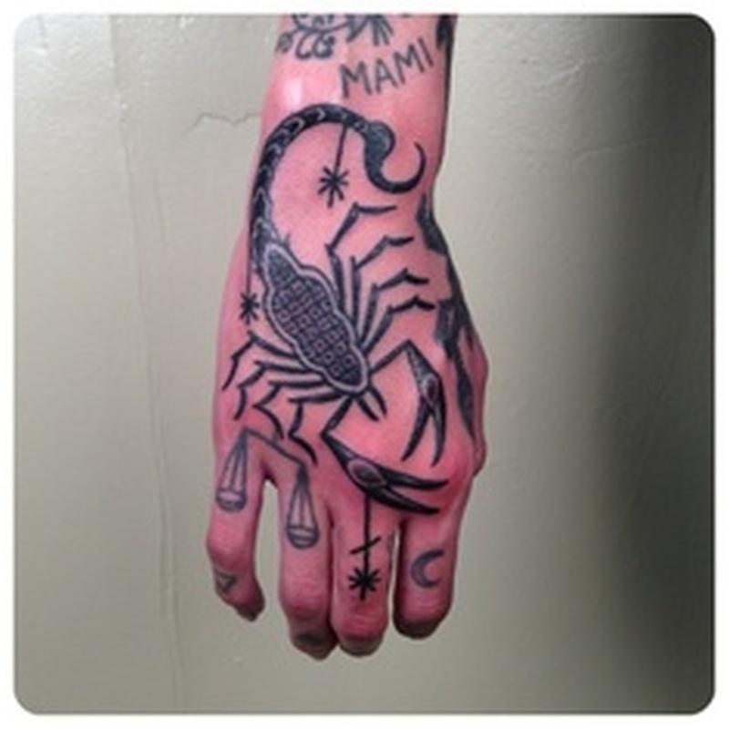 Scorpion hand picture tattoo
