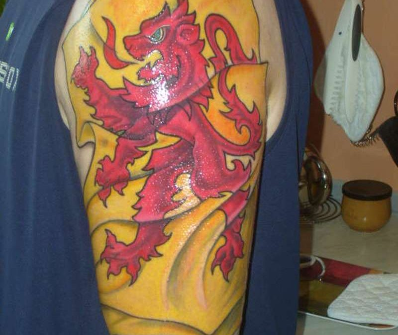 Scottish rampant lion flag tattoo on arm