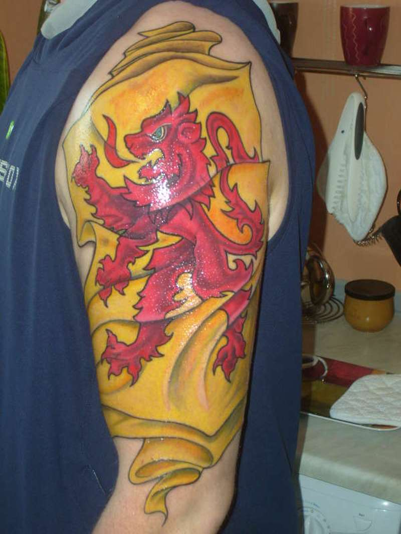 Scottish rampant lion flag tattoo on arm