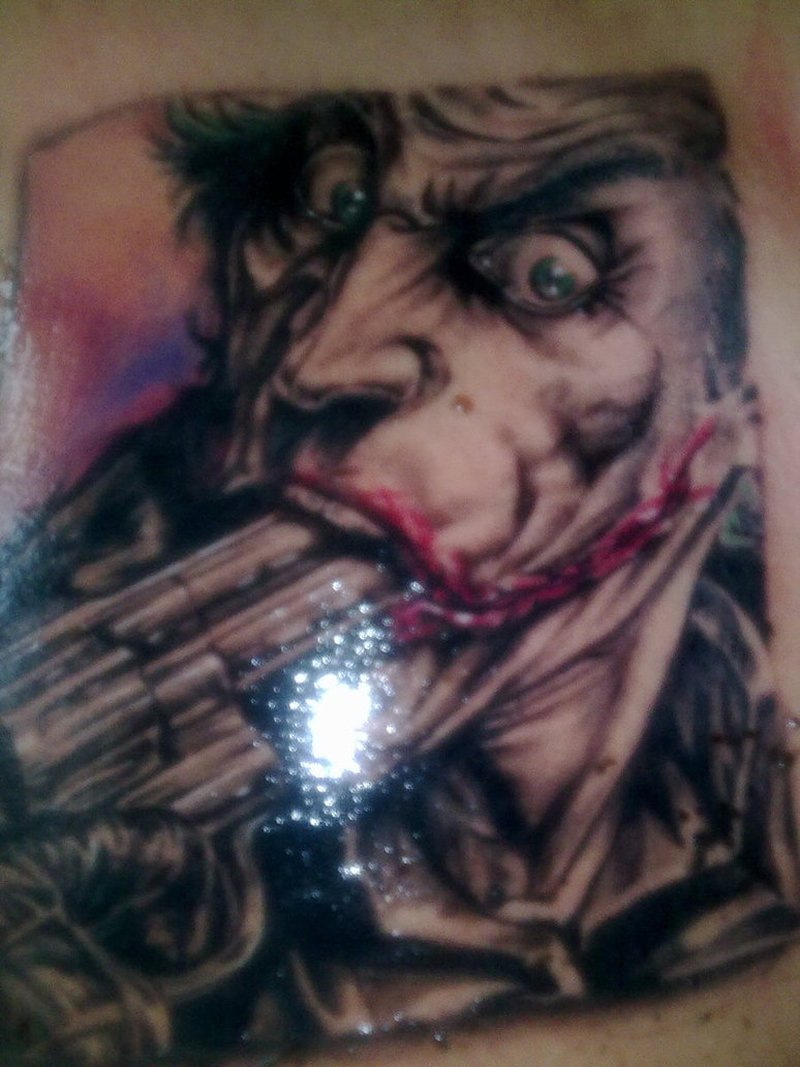 Shining gangsta joker tattoo design