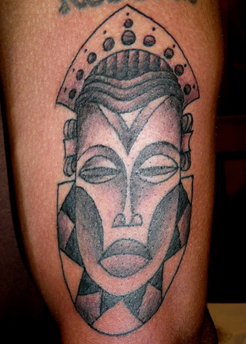 Simple african mask tattoo
