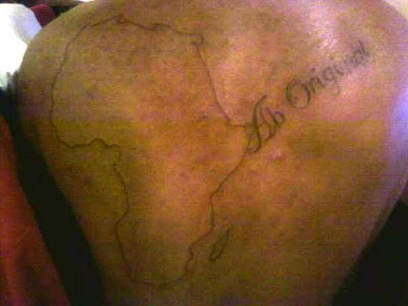 Simple african outline map tattoo on back