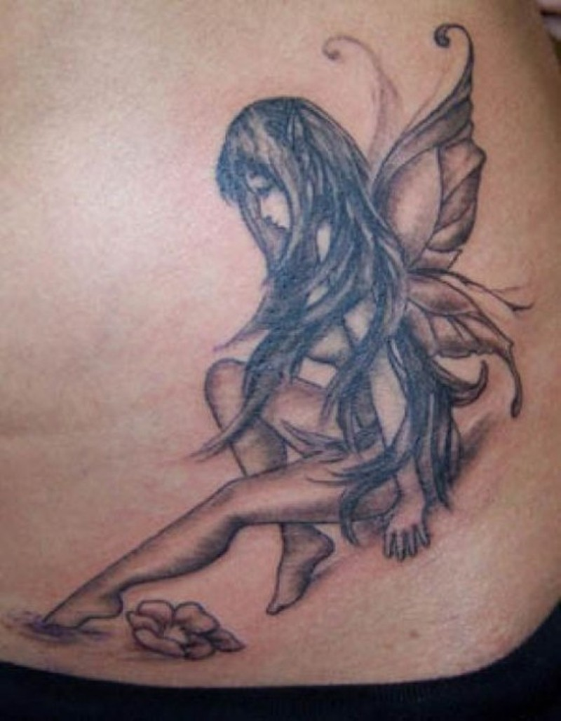 Sitting angel girl tattoo design