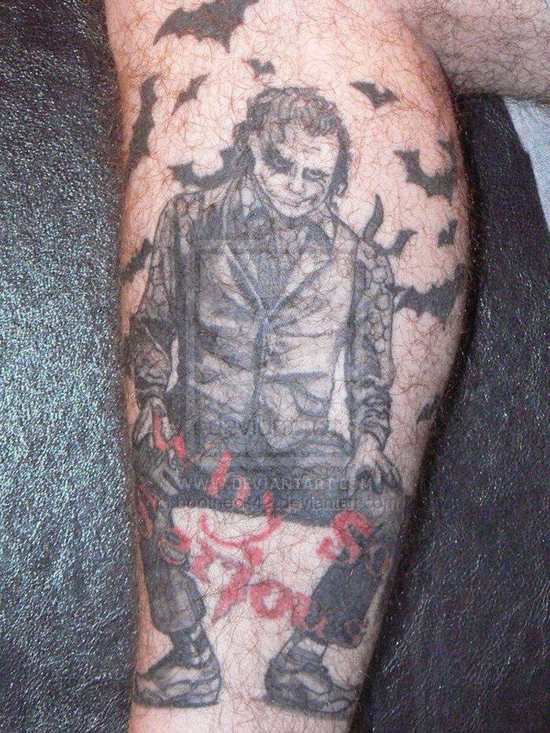 Sitting batman joker tattoo design