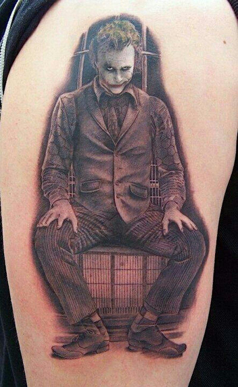 Sitting joker tattoo on biceps tattoos book for The joker tattoo