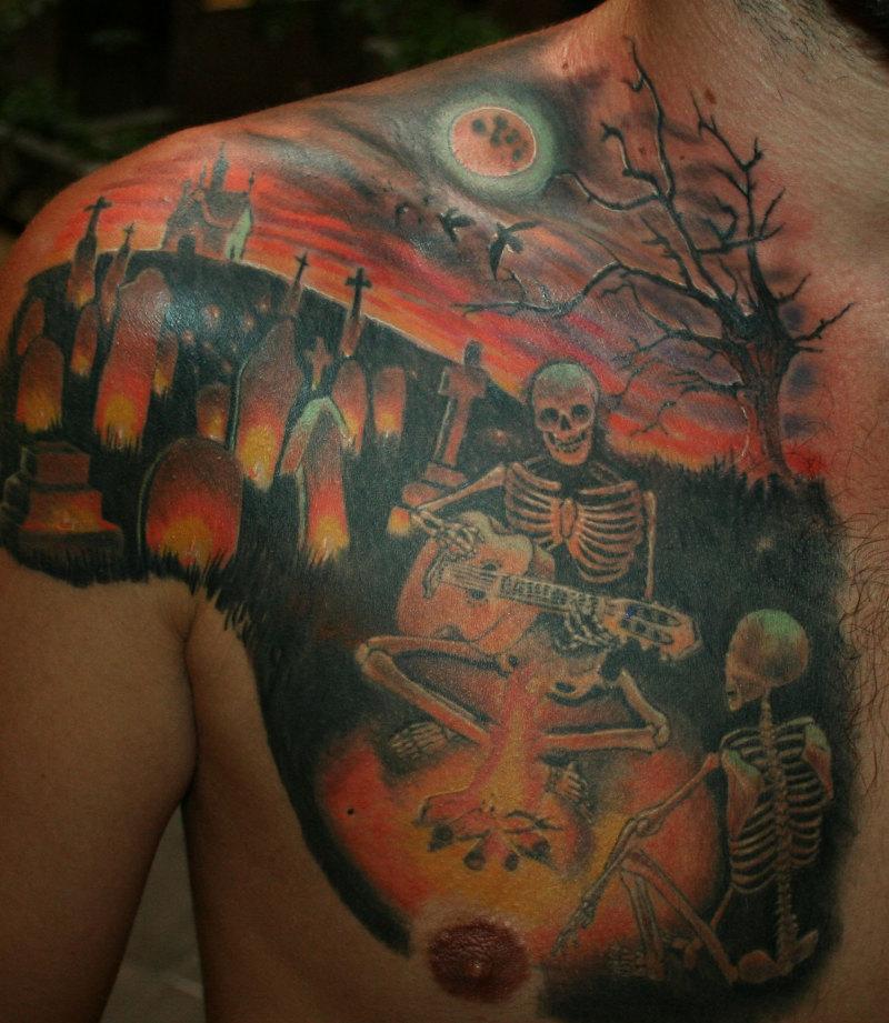 Skeleton graveyard tattoo design on chest