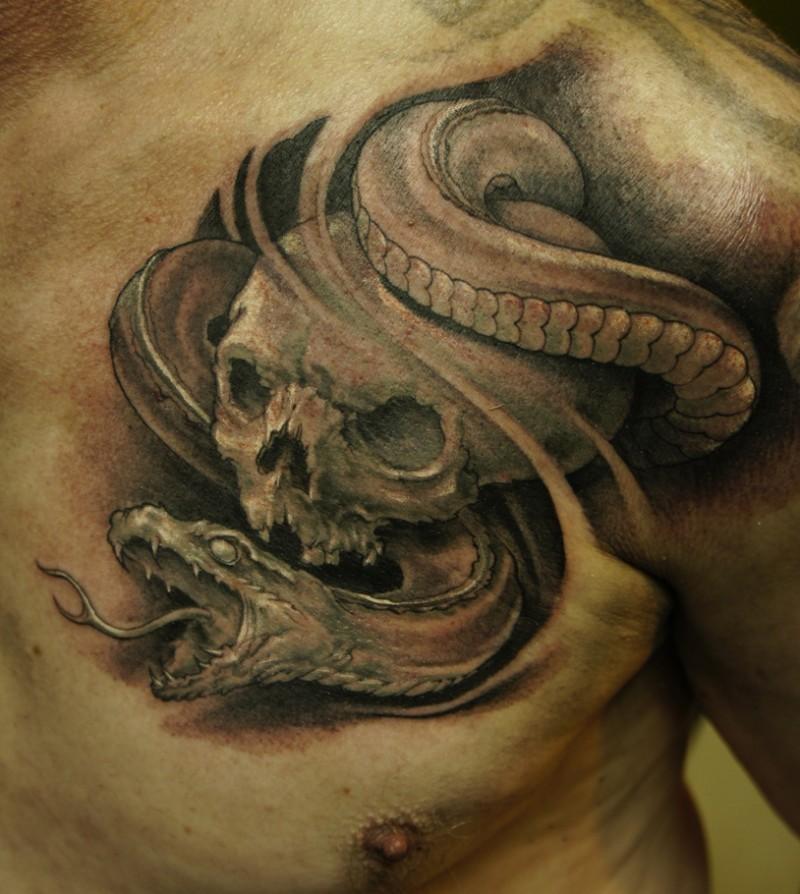 Skull and snake tattoo on chest for men
