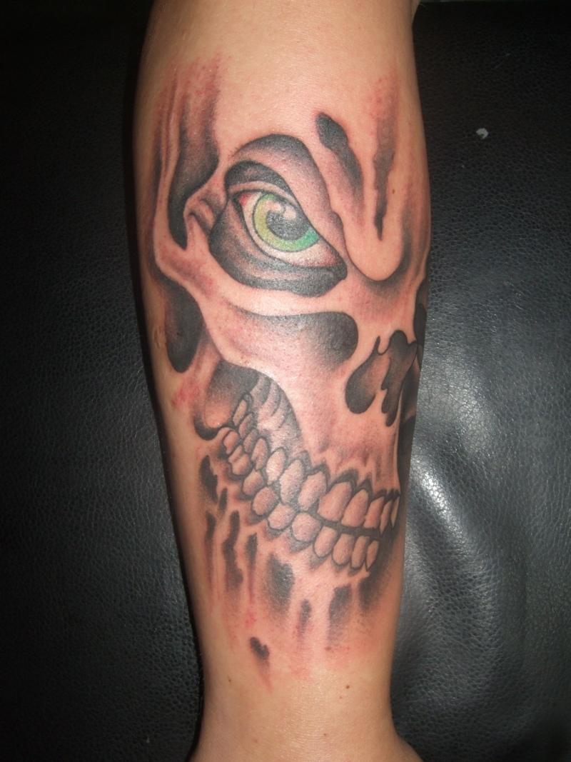 Skull flames arm horror tattoo design