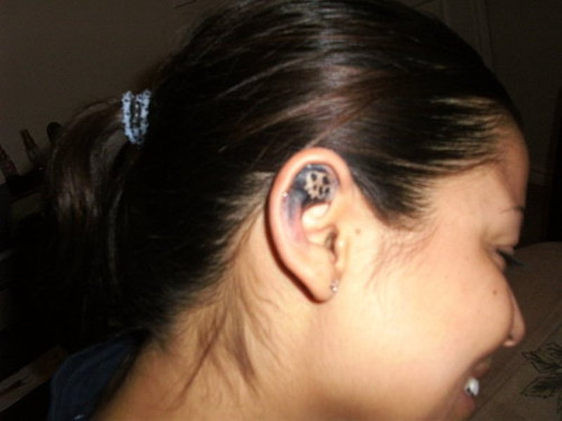 Skull tattoo in ear 2