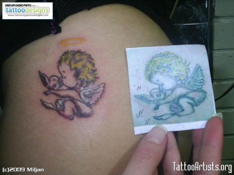 Small baby angel with bird tattoo design tattoos book for Baby s first tattoo book