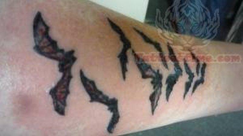 Small bats tattoo on arm