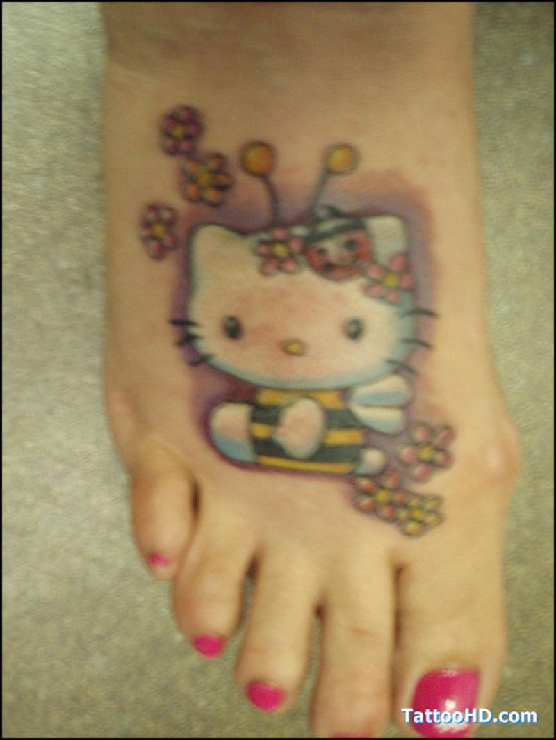Small bumblebee on foot tattoo