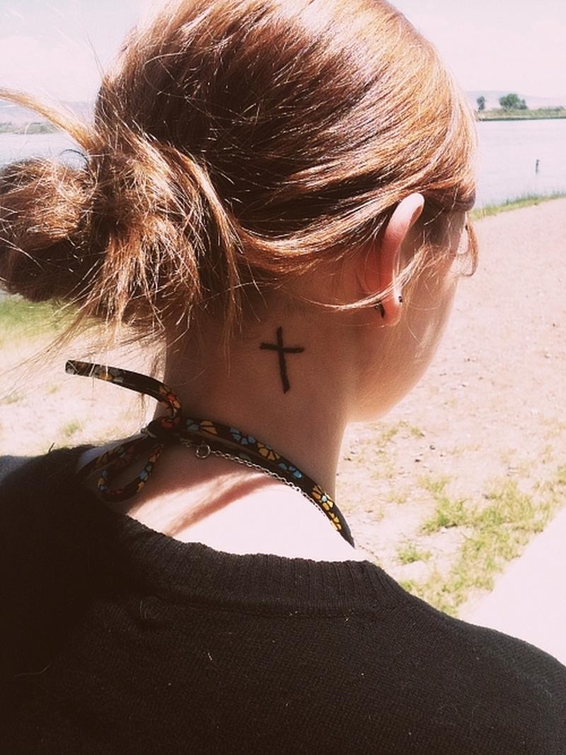 Small cross tattoo on neck