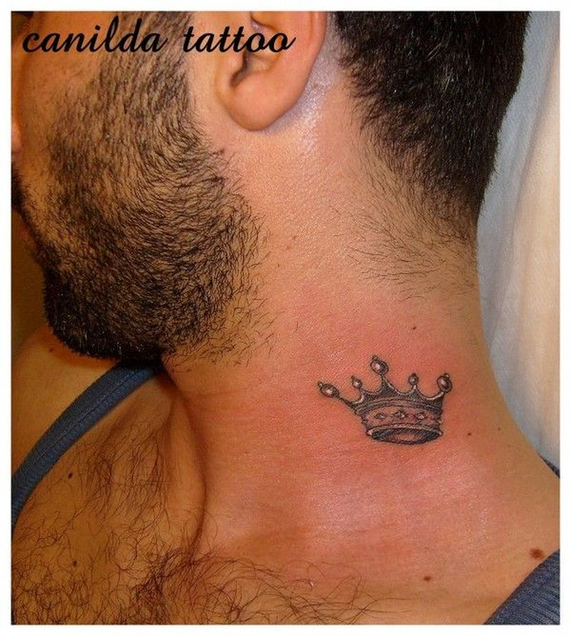 Small crown tattoo on neck