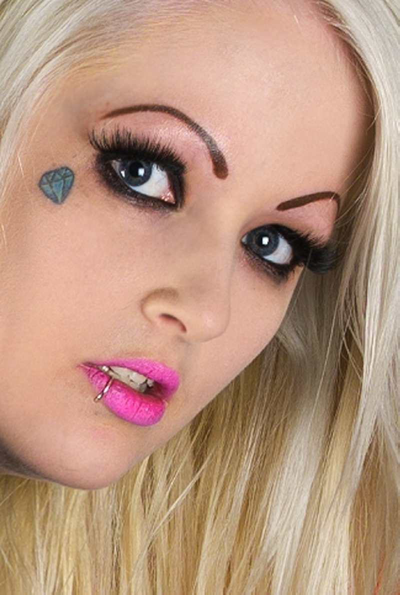 Small diamond tattoo on face n lip piercing
