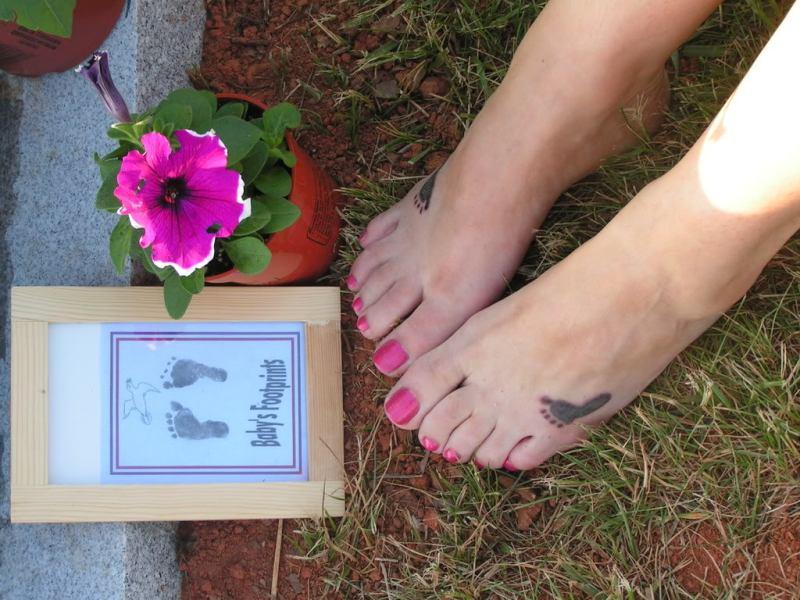 Small footprints tattoo on feet