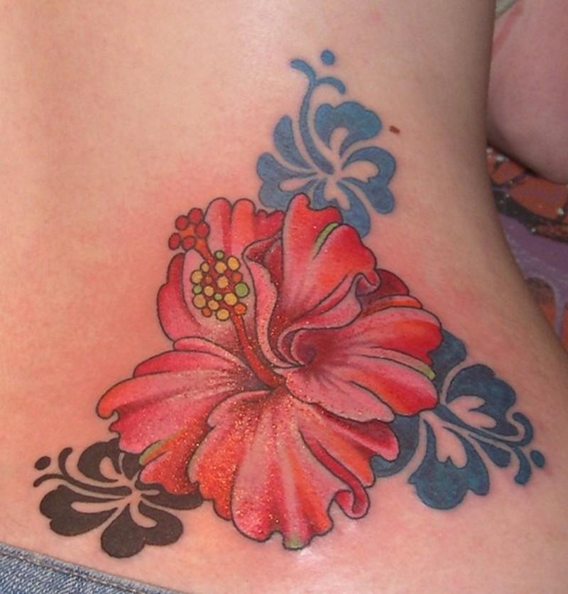 Small hibiscus flower tattoo on waist