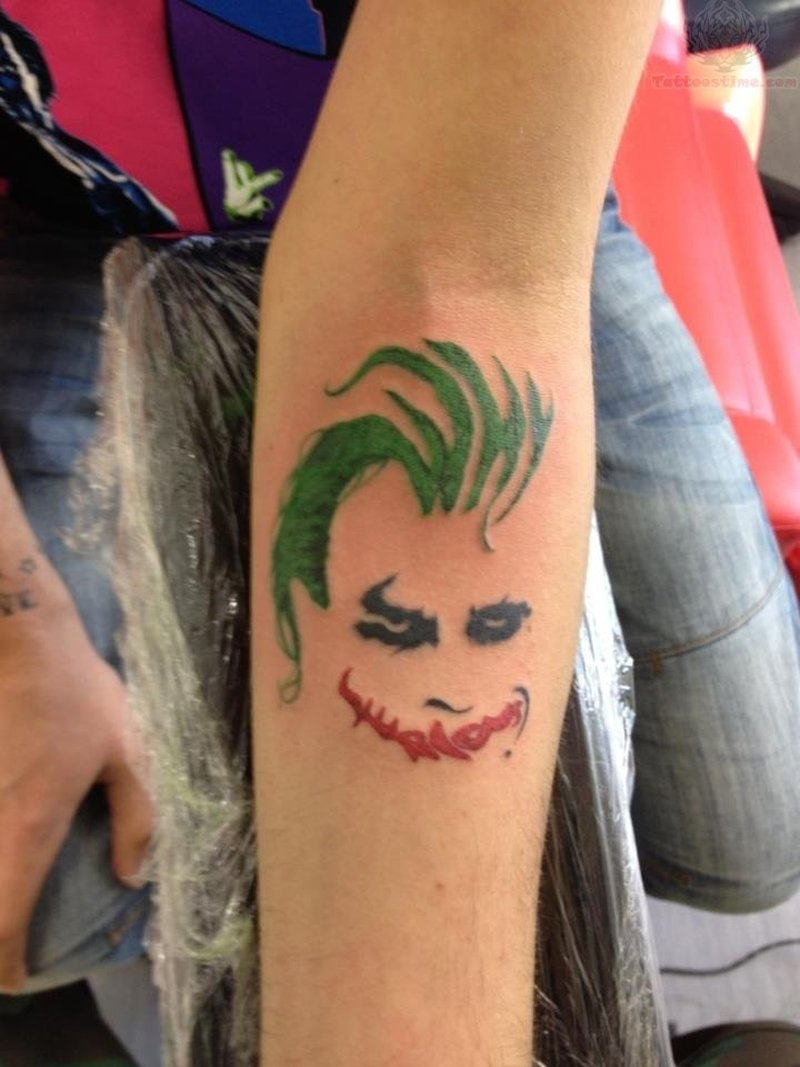 Small joker head tattoo on arm tattoos book for Small bicep tattoos