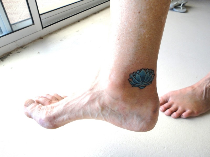 Small lotus ankle tattoo