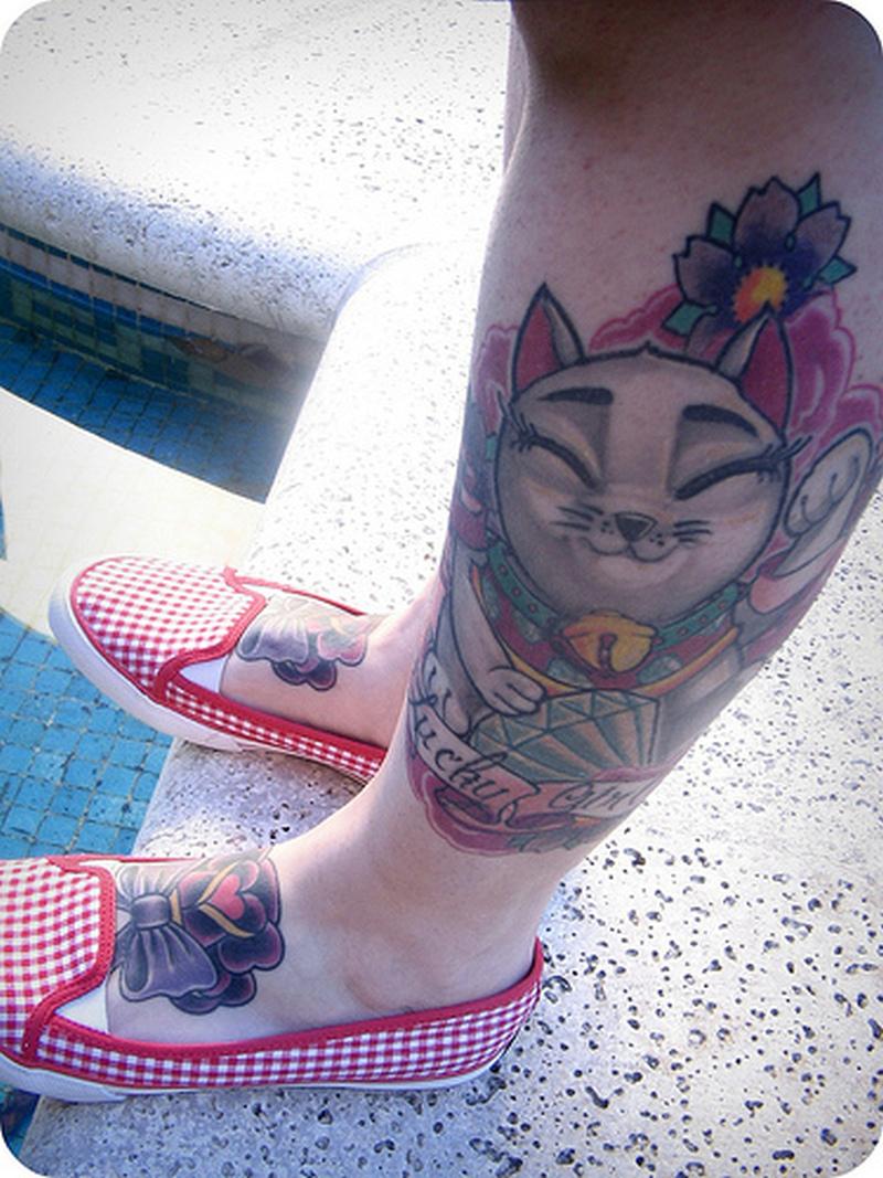 Smiling cat tattoo on leg