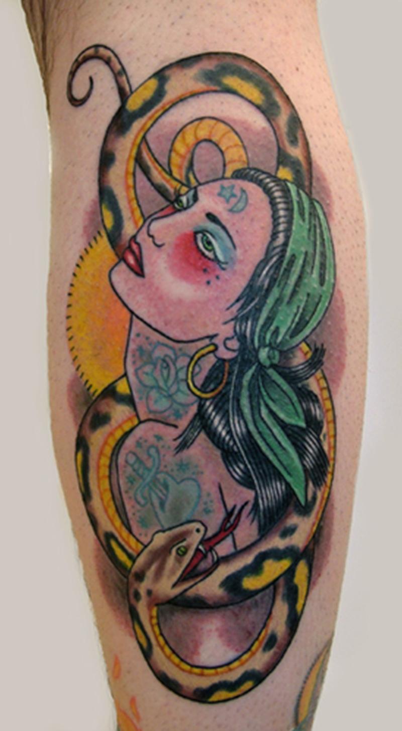 Snake around gypsy tattoo design