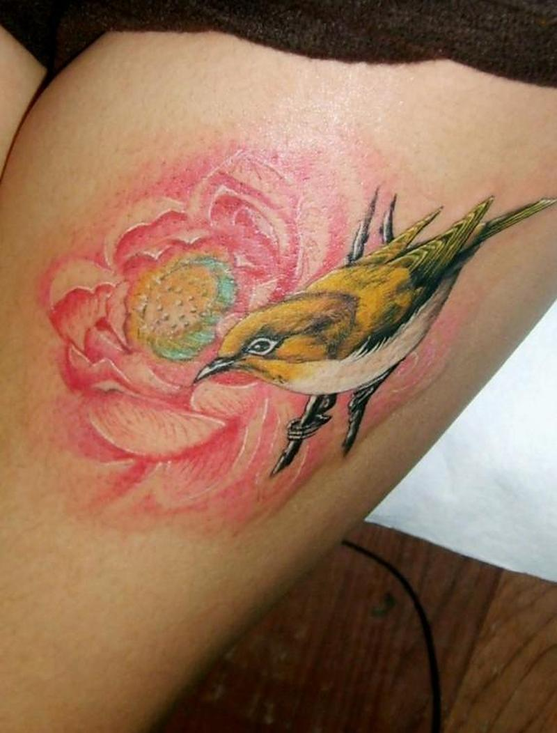 Sparrow bird tattoo on thigh