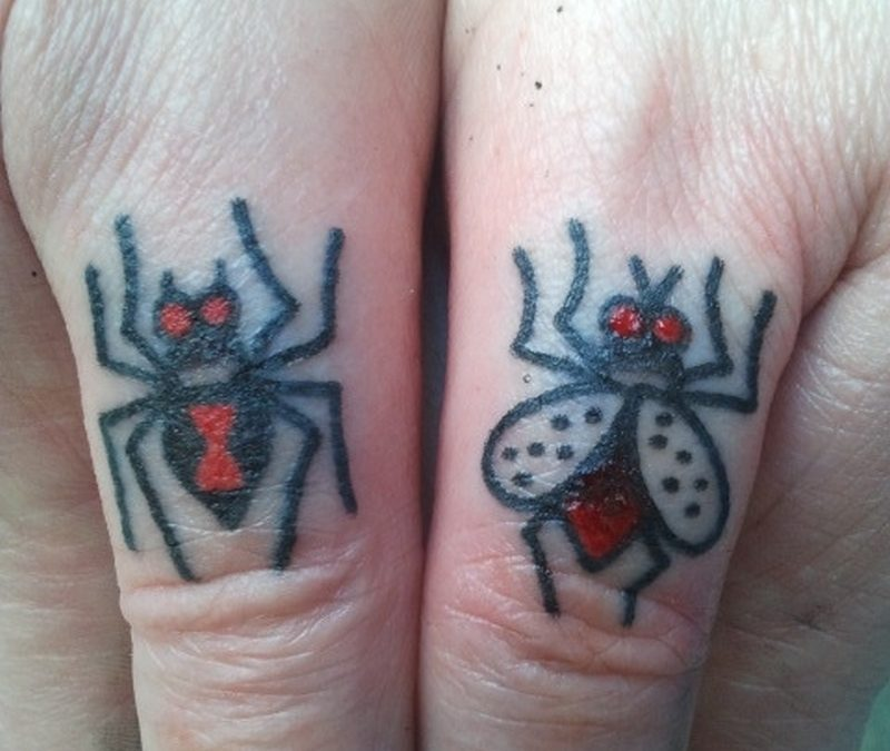 Spider n fly insect tattoo on thumbs