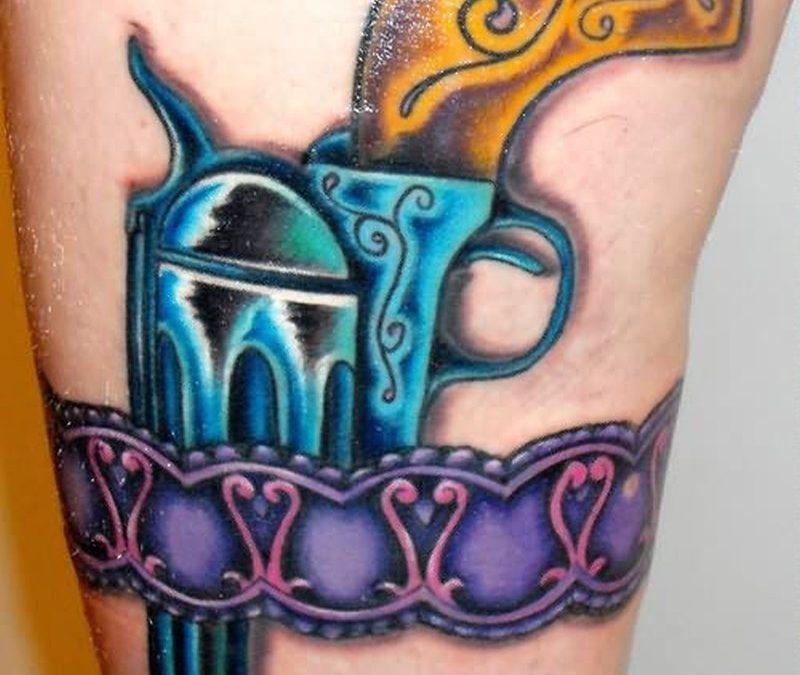 Stylish gun armband tattoo