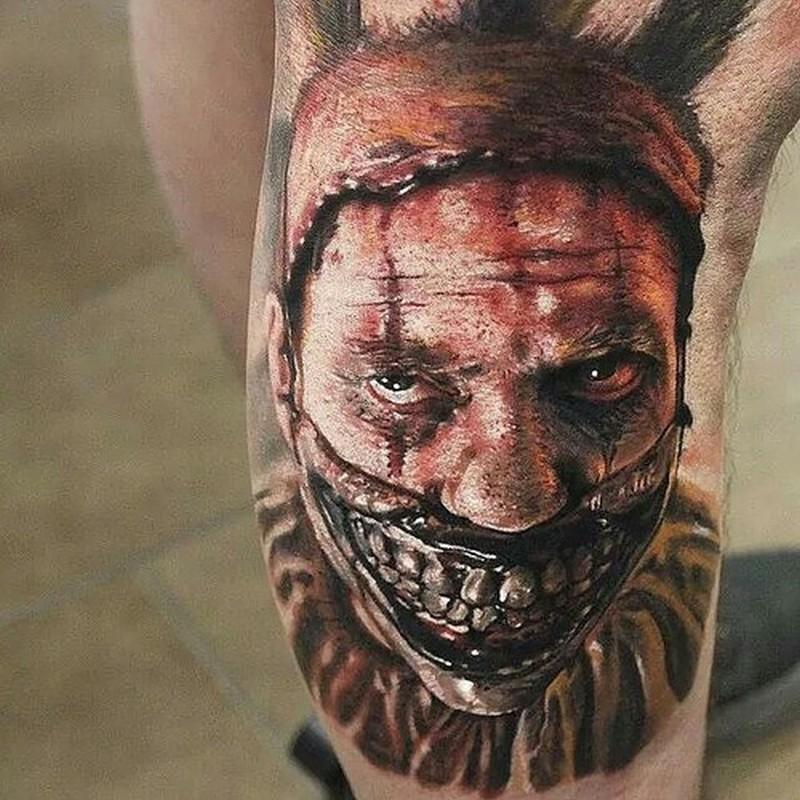 Super realistic spooky clown tattoo